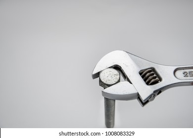 Wrench and bolt on white background
