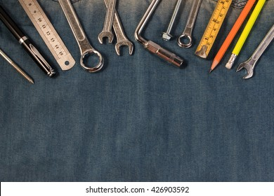 Wrench engineer constructor tools on a denim workers, A jeans with engineer constructor tools. Several engineer constructor tools on a denim workers. Set of engineer hand tools for background.