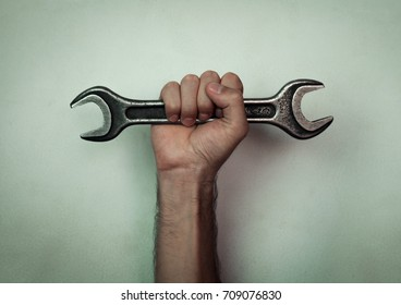 Wrench on hand.