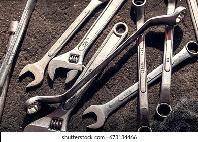 wrench, spanner, monkey wrench, screw wrench, diverse wrench tools on dirty cloth in garage