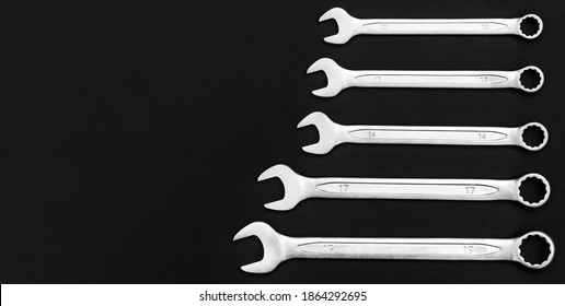 Wrenches on a black background. Copy space.