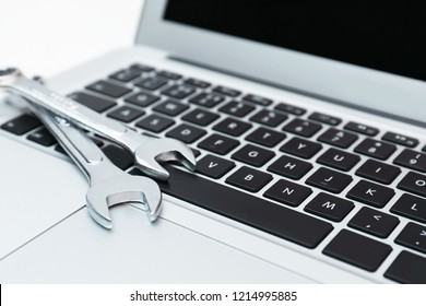 Wrenches on computer keyboard. Concept of technical support