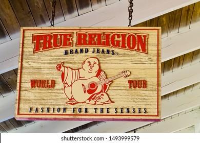 Wrentham, Massachusetts/United States -8/15/2019: Wood name board of true religion brand jean in wrentham village premium outlets