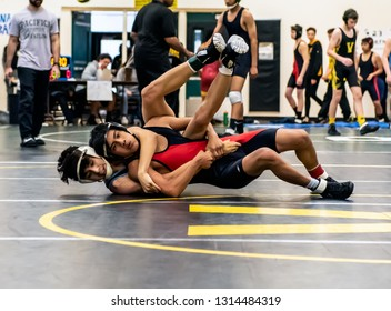 Wrestler from Buena High School attempting gain control on Rio Mesa athlete during tournament at Ventura High School in California USA on February 2, 2019.