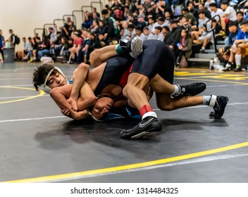 Wrestler from Buena High School attempting a tilt on Rio Mesa athlete during tournament at Ventura High School in California USA on February 2, 2019.
