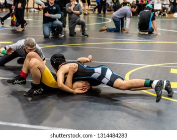 Wrestler from Buena High School holding Ventura athlete on his back during tournament at Ventura High School in California USA on February 2, 2019.