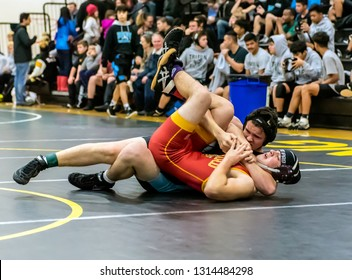 Wrestler from Buena High School holding a cradle on Oxnard athlete during tournament at Ventura High School in California USA on February 2, 2019.