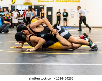 Wrestler from Buena High School lifting ankle of Ventura athlete during tournament at Ventura High School in California USA on February 2, 2019.