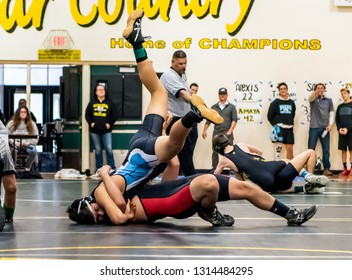 Wrestler from Buena High School resisting a tilt by Rio Mesa athlete during tournament at Ventura High School in California USA on February 2, 2019.