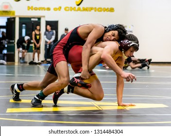 Wrestler from Oxanrd High School attempting an escape on Rio Mesa athlete during tournament at Ventura High School in California USA on February 2, 2019.