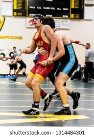Wrestler from Oxnard High School attempting to break grip of Buena athlete during tournament at Ventura High School in California USA on February 2, 2019.