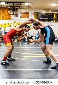 Wrestler from Oxnard High School attempting to gain advantage on feet against Buena athlete during tournament at Ventura High School in California USA on February 2, 2019.