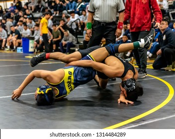 Wrestler from Pacifica High School attempting a tilt on Channel Islands athlete during tournament at Ventura High School in California USA on February 2, 2019.
