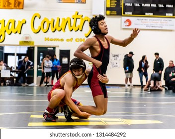 Wrestler from Rio Mesa High School attempting an escape on Oxnard athlete during tournament at Ventura High School in California USA on February 2, 2019.