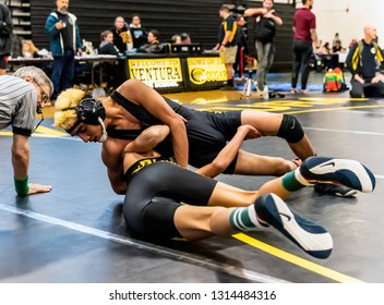 Wrestler from Rio Mesa High School attempting a pin on Ventura athlete during tournament at Ventura High School in California USA on February 2, 2019.