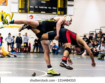 Wrestler from Ventura High School driving Rio Mesa athlete off his feet during tournament at Ventura High School in California USA on February 2, 2019.