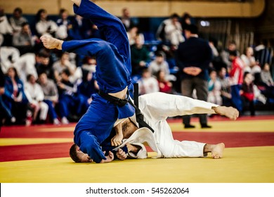 wrestling athletes judoka on tatami and competition in judo