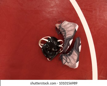 Wrestling gear on mat
