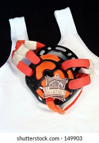 wrestling head gear and medal on a singlet