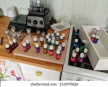 Wrexham, UK - May 11, 2019: Collection of Essential oils on a kitchen worktop. Brands from Young Living, NHR and Original Swiss Aromatics. Both medicinal and food grades.