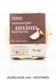 WREXHAM, UK - MAY 24, 2017: Tub of Tesco own brand caramelised onion houmous suitable for vegans. On a white background.