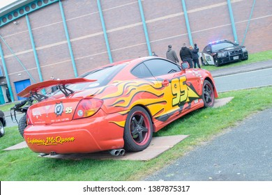 Wrexham, Wales - April 28th, 2019: Wales Comic Con - Cars Lightning McQueen and Gotham City Police Department Car