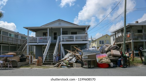 Wrightsville Beach, NC  - October 1, 2018: Weeks after Hurricane Florence, residents and businesses are still cleaning up on the road to recovery. Flood damaged furniture and building materials.