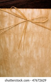 Wrinkle paper background with straw bow. - Shutterstock ID 47672629