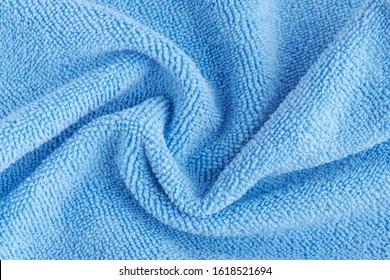 Wrinkled blue microfiber cloth texture of microfiber towel closeup