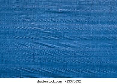 Wrinkled blue tarp texture