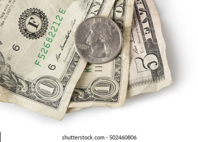 Wrinkled dollar bills and a quarter adding up to $7.25, the current (as of 2016) U.S. Federal Minimum wage.