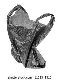 wrinkled empty trash bag isolated on white background. old black crumpled polyethylene pack.
