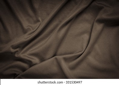Wrinkled fabric texture. Close-up of soft cotton cloth, may be used as background.