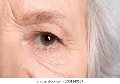 Wrinkled face of elderly woman, closeup of eye