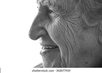 wrinkled face of a happy senior woman