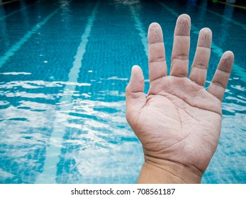 wrinkled hand because of soak in the water for a long time