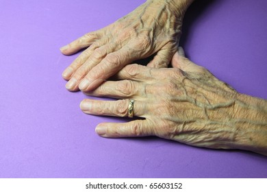 wrinkled hands of a ninety year old woman
