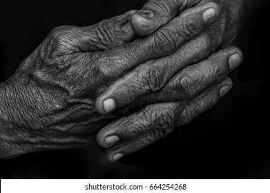 Wrinkled hands of an old man. , Black and white photography. ( low key)