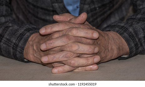 wrinkled hands of an old man closeup