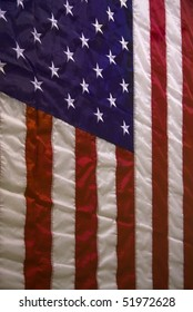 Wrinkled hanging American flag for a background.