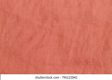 Wrinkled linen fabric background. Linen fabric texture. Stone washed pink pure linen background