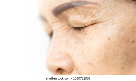 wrinkled and lines of old asian woman eyelid skin texture in closeup selective focus