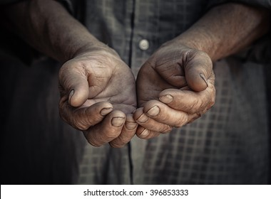 Wrinkled old hands begging asking for money. Closeup portrait senior elderly wrinkled hands isolated dark black background. Human emotions attitude reaction, body language. Charity Concept sign symbol