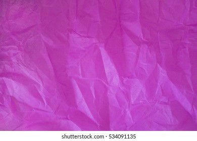 Wrinkled pink paper texture and background