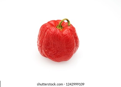 A wrinkled red bell peppers or capsicum isolated on white background.