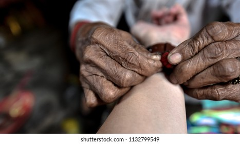 Wrist binding : A Thai traditional ceremony to console the people's Kwǎn based on Thais' belief of having good spirit inside people's entire body which affects people's thinking and body health.