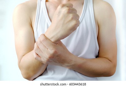 Wrist and Hand of sport man is injured and symptomatic Office Syndrome, Close up view.