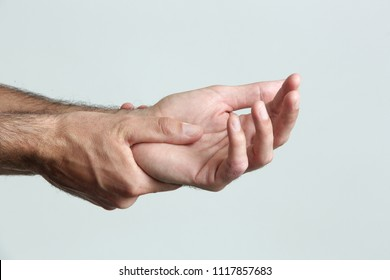 Wrist injury, man with Carpal tunnel syndrome symptom