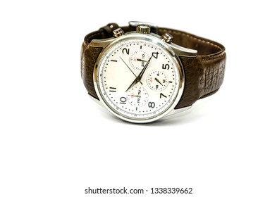 wrist watch with brown, leather strap close-up on white