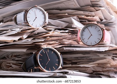 Wrist watch collection on old newspaper